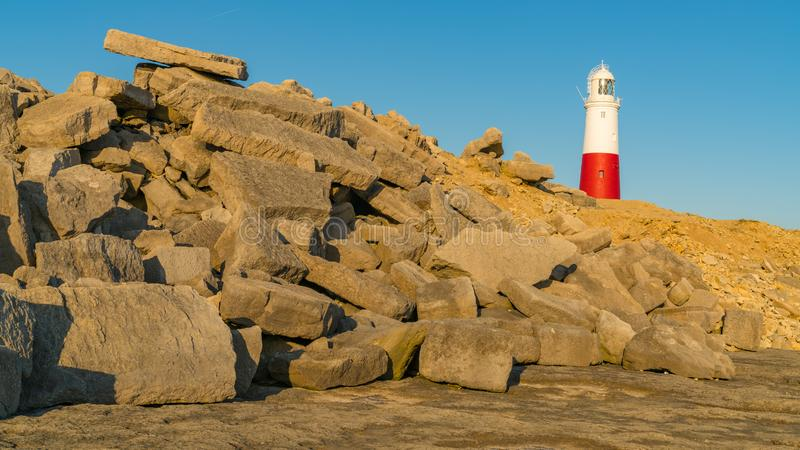 Portland Bill Lighthouse, Jurassic Coast, Dorset, UK. Portland Bill Lighthouse seen from the rocks near Pulpit Rock, Jurassic Coast, Dorset, UK royalty free stock photo