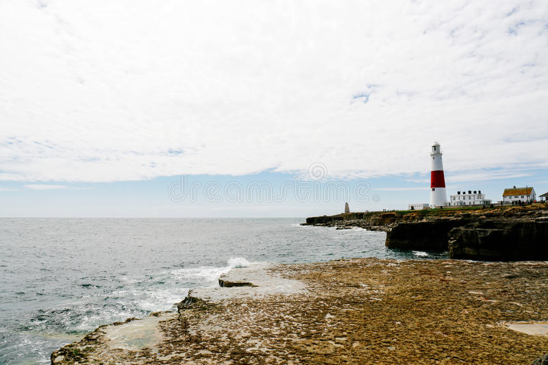 Portland Bill Lighthouse. A landscape view of sea, coastline and Portland Bill Lighthouse in Dorset, England stock photography
