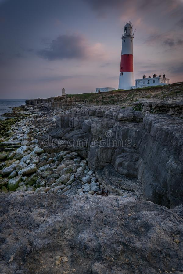 PORTLAND BILL LIGHTHOUSE AT SUNSET IN DORSET. WITH THE SUN SETTING royalty free stock photo