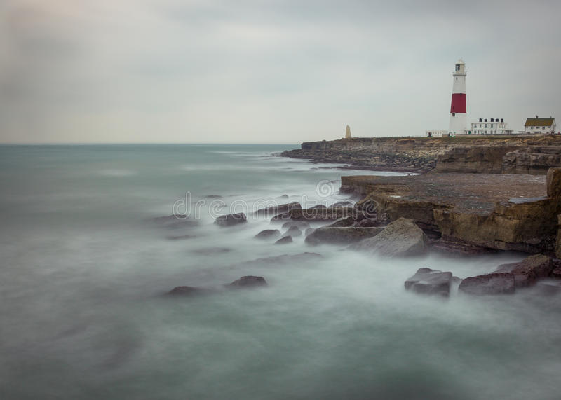 Portland Bill Lighthouse. Waves crashing in at Portland Bill Lighthouse. It is a functioning lighthouse at Portland Bill, on the Isle of Portland, Dorset royalty free stock photography