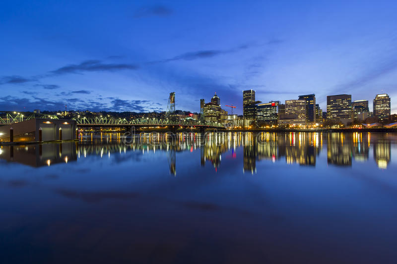 Portland City Downtown Cityscape Blue Hour. Portland Oregon downtown city skyline by Hawthorne Bridge over Willamette River waterfront during evening blue hour royalty free stock photo