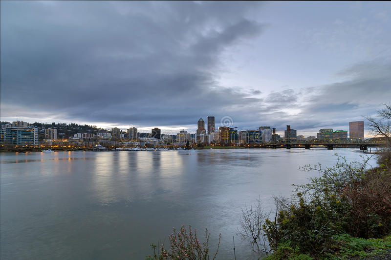 Portland City Downtown Cityscape during Evening. Portland Oregon downtown city skyline and Hawthorne Bridge over Willamette River waterfront during evening stock photos
