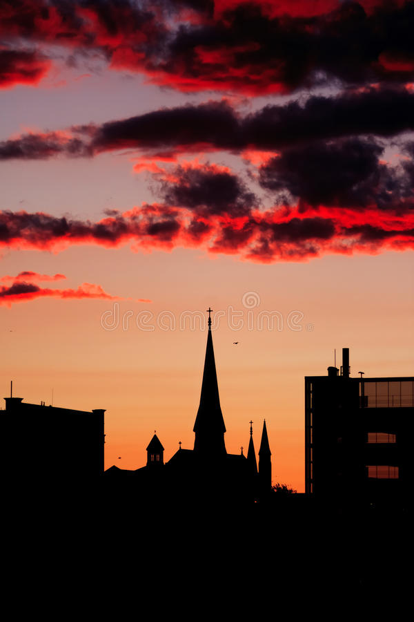 Portland city silhouette. Vertical silhouette image of downtown Portland, Maine, taken at night from a cruise ship with a cathedral centered in the image stock photo