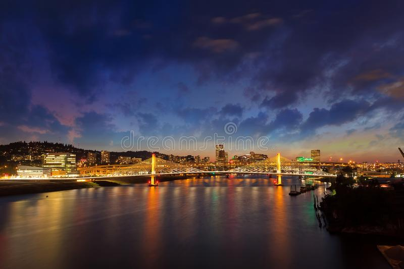 Portland OR City Skyline by Tilikum Crossing at night. Portland Oregon downtown city skyline by Tilikum Crossing Bridge over Willamette River at night stock image