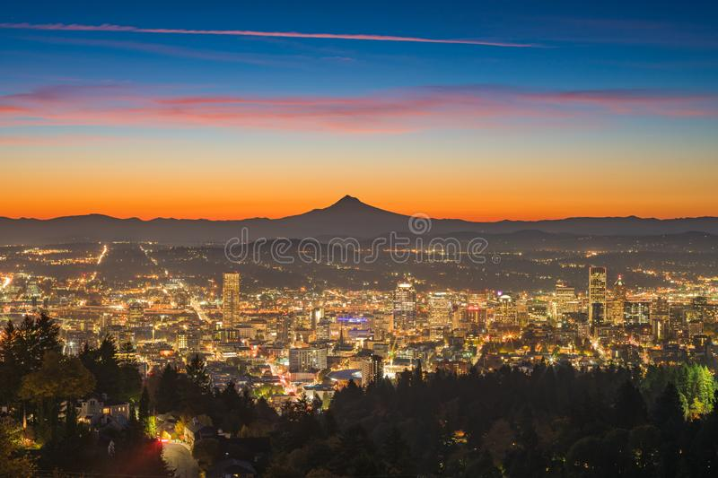 Portland downtown and Mt Hood at dawn. This is a photograph of Portland downtown and Mt Hood at dawn royalty free stock images