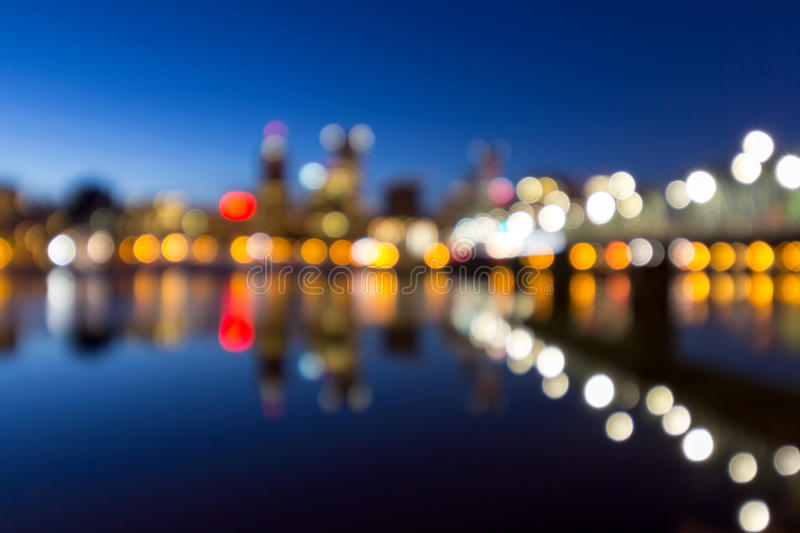 Portland Downtown Skyline Blue Hour Blurred Defocused Bokeh. Portland Oregon downtown skyline along Willamette River during blue hour blurred defocused bokeh stock photography