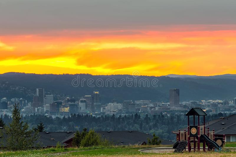 Portland OR Downtown Skyline by Childrens Playground. Portland Oregon downtown city skyline by childrens playground in Altamont Park on Mt Scott during sunset stock photos