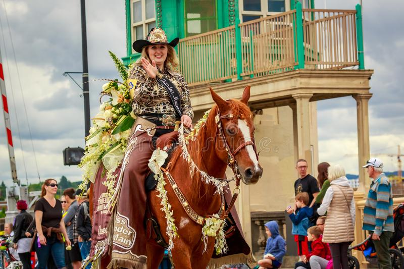 Portland Grand Floral Parade 2019. Portland, Oregon, USA - June 8, 2019: Miss Thunder Mountain Pro Rodeo Queen, Makenzie Matthews in the Grand Floral Parade royalty free stock images