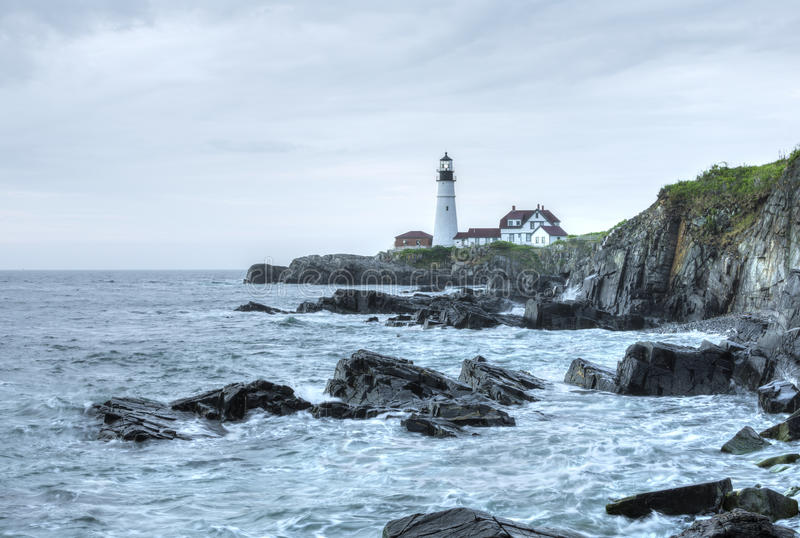 Portland Head Light lighthouse on rugged Maine coast stock images