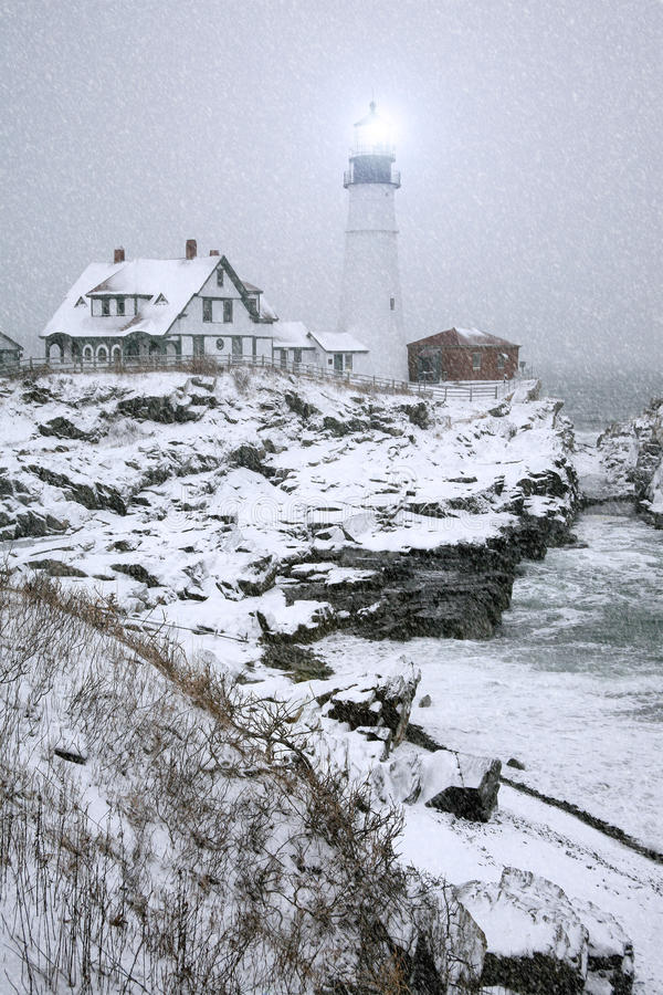 Portland Head Light Snow Storm. Winter view of the Portland Head Light in Maine during snow storm royalty free stock image