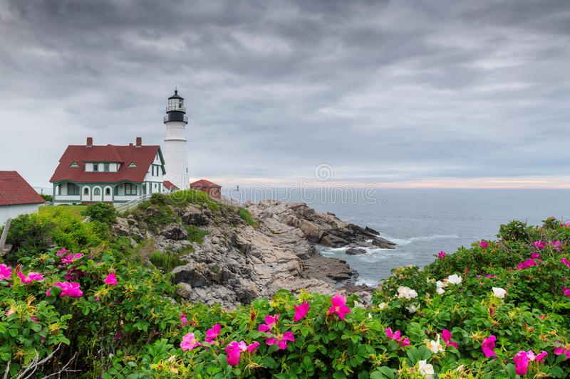 Portland Head Light at summer cloudy day and flowers in Maine, New England. royalty free stock photography