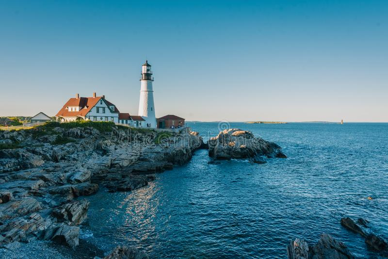 Portland Head Lighthouse and the Atlantic Ocean at Fort Williams Park in Cape Elizabeth, Maine royalty free stock photo