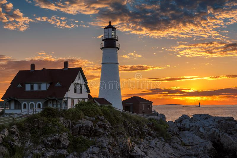 Portland Lighthouse at sunrise, Maine, USA. Portland Head Lighthouse in Cape Elizabeth, Maine, USA. One Of The Most Iconic And Beautiful Lighthouses stock photos