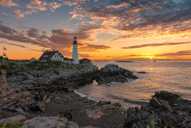 Portland Lighthouse at sunrise in New England, Maine. Portland Head Lighthouse in Cape Elizabeth, New England, Maine, USA. One Of The Most Iconic And Beautiful stock photography