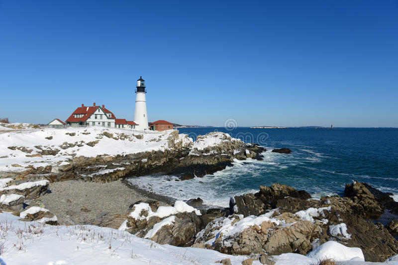 Portland Head Lighthouse, Maine. Portland Head Lighthouse in winter, Cape Elizabeth, Maine, USA. This lighthouse was built in 1791, and is the oldest lighthouse royalty free stock photos