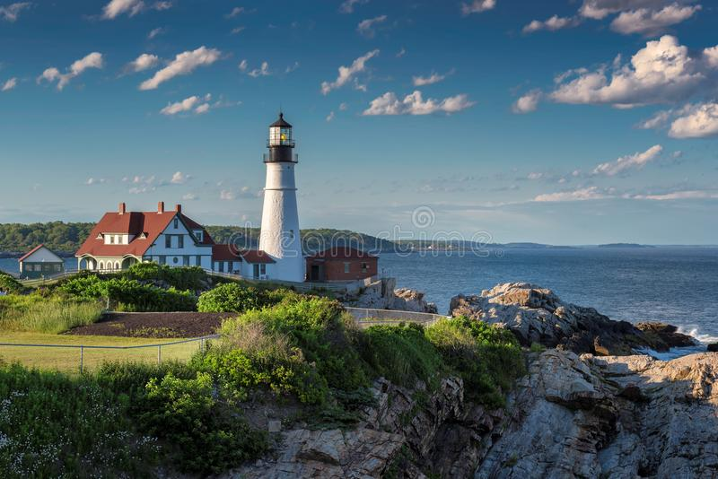 Portland Head Light at sunset in Cape Elizabeth, Maine, USA. Portland Lighthouse at sunset in Cape Elizabeth, Maine, USA. One of the most Iconic and beautiful royalty free stock photography