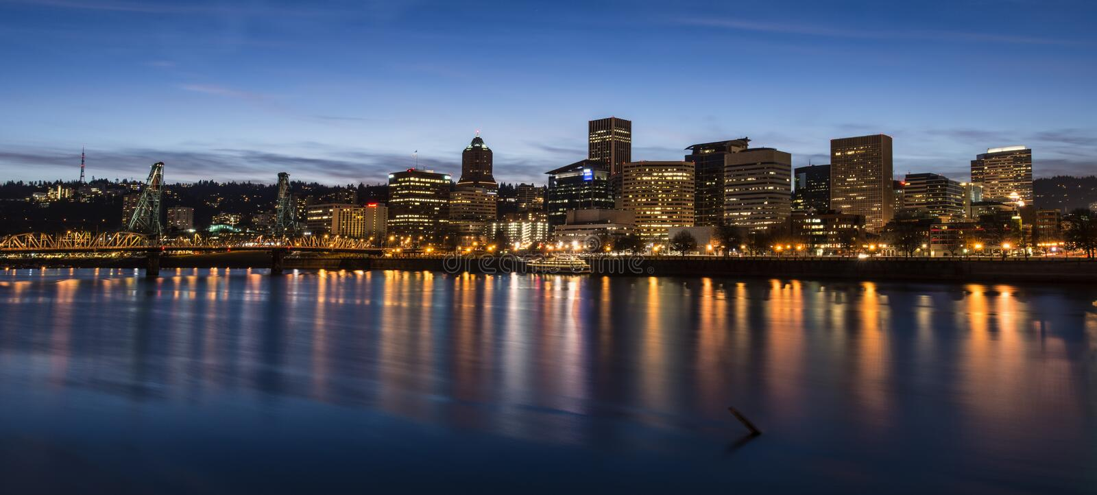 Portland Lights. Downtown Portland is reflected in Willamette River. The view of skyline is especially beautiful at night royalty free stock photos