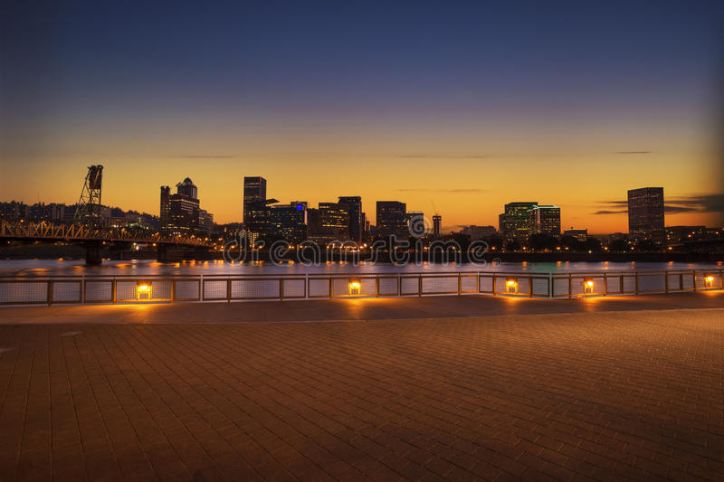 Portland, Oregon city skyline panorama with Hawthorne bridge. Colorful sunset sky and light reflection on the Willamette river royalty free stock image