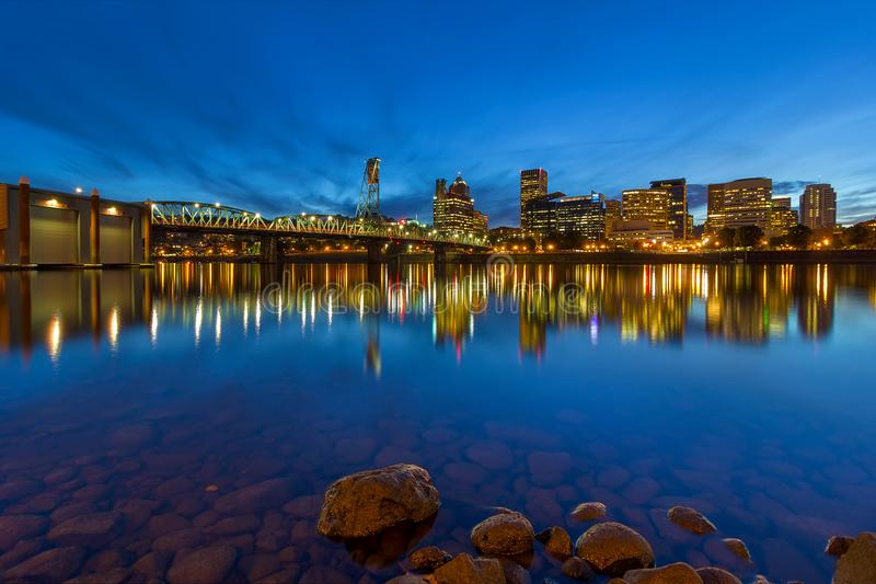 Portland OR by Hawthorne Bridge Blue Hour. Portland Oregon downtown city skyline by Hawthorne Bridge from Eastbank Esplanade during evening blue hour stock images