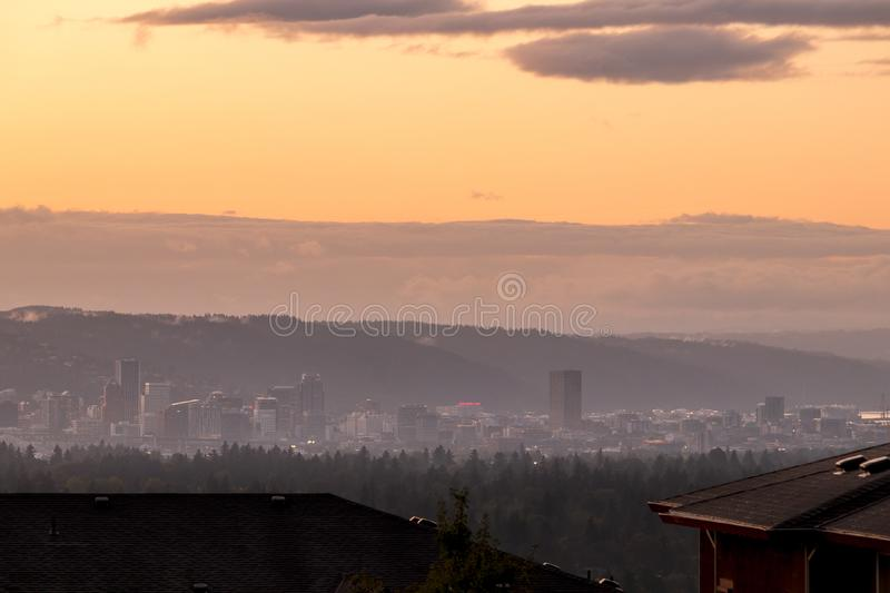 Portland, Oregon downtown cityscape skyline seen from a far distance away during a very beautiful sunset stock images