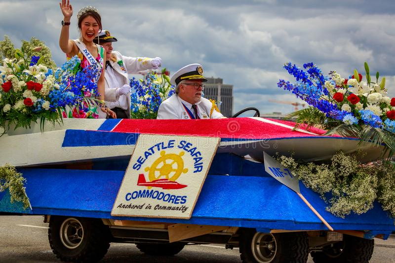 Portland Grand Floral Parade 2019. Portland, Oregon, USA - June 8, 2019: Seattle Seafair Commodores Mini-Float in the Grand Floral Parade, during Portland Rose royalty free stock photography
