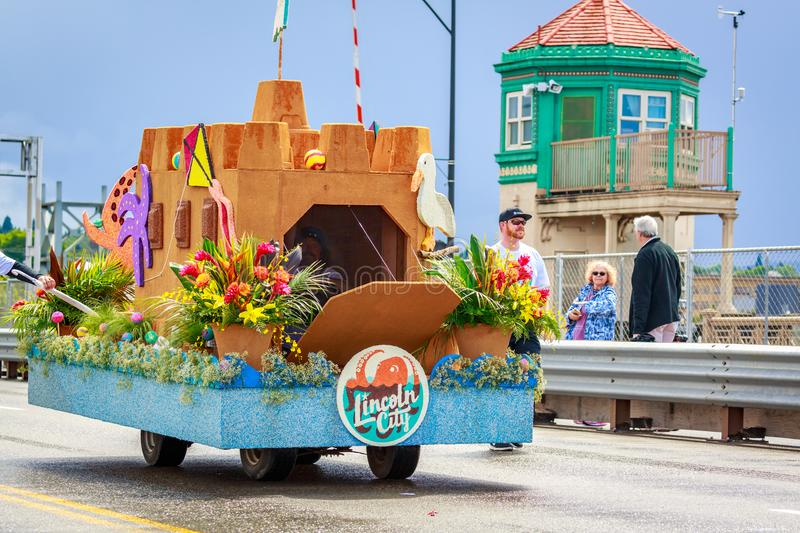 Portland Grand Floral Parade 2018. Portland, Oregon, USA - June 9, 2018: Travel Lincoln City Mini-Float in the Grand Floral Parade, during Portland Rose Festival royalty free stock photography