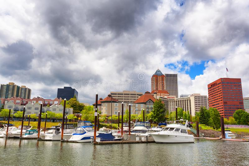 Waterfront View of Portland, Oregon. Portland, Oregon,USA - May 29, 2010: View from the east shore of the Willamette River looking toward River Place marina stock image