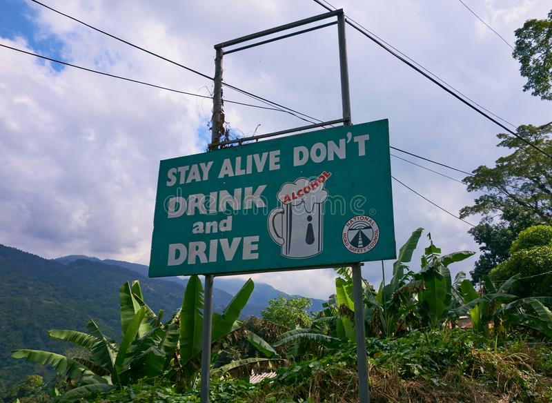 Green Don`t drink and drive road safety sign by the side of the road in Portland Parish, Jamaica. stock image