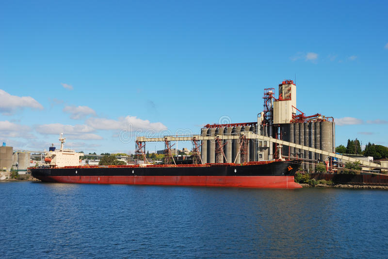 Portland Ship. Alam Pesona getting her load of grain on the Willamette waterfront in Portland Oregon royalty free stock photo