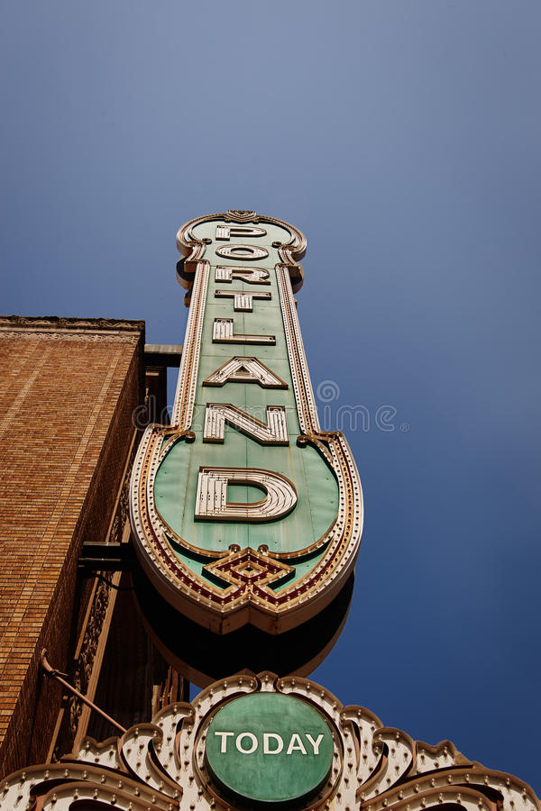Portland sign from 30's on brick building from below. In Portland, Oregon, USA with clear blue sky royalty free stock image