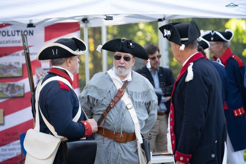 Elderly people dressed in civil war era costumes. stock photos