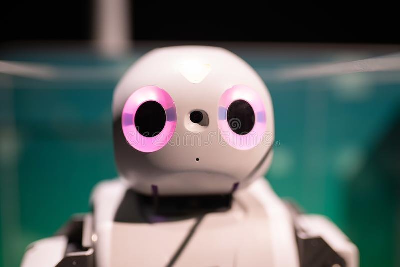 Cute robot with big pink eyes. Portland, OR / USA - July 14 2018: Cute robot with big pink eyes at the OMSI exhibit stock images