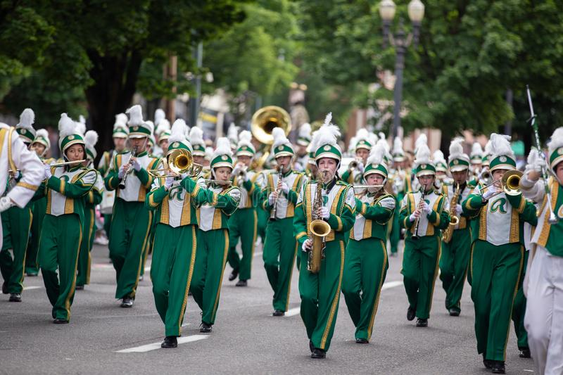Flute and trumpet players at grand floral parade royalty free stock image