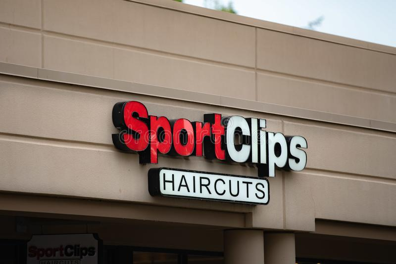 SportClips haircuts logo sign. Portland, OR / USA - June 20 2018: SportClips haircuts logo sign on the side of the building stock images