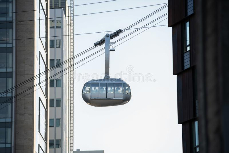 Aerial Tram AirTram taking people up onto the hill. Portland, OR / USA - November 15 2018: Aerial Tram AirTram taking people from OHSU waterfront up to the hill stock images