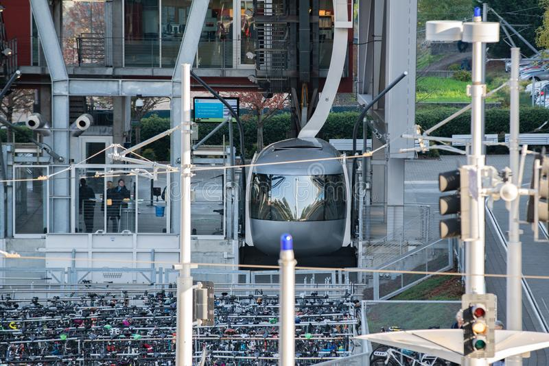 AirTram docked at the load station. Portland, OR / USA - November 15 2018: Portland AirTram aerial lift transport cabin at the docking station stock photos