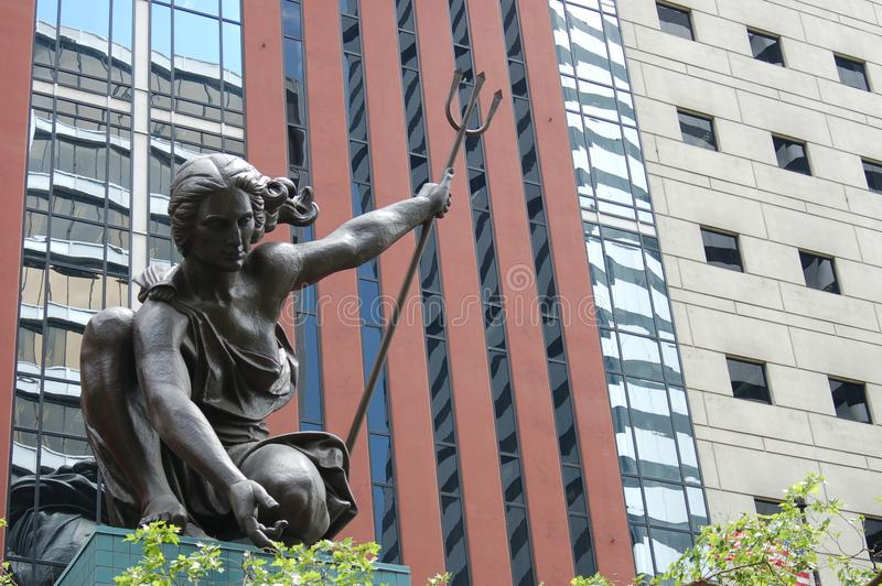 `Portlandia` statue in downtown, Portland, Oregon. This is the `Portlandia` statue in front of an office building in downtown Portland, Oregon stock photography