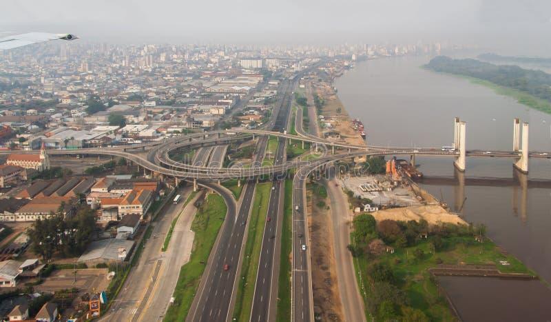 Porto Alegre Bridge and Guaiba River. The cityscape of Porto Alegre downtown in the horizon and the bridge over Guaiba river. Rio Grande do Sul, Brazil stock images