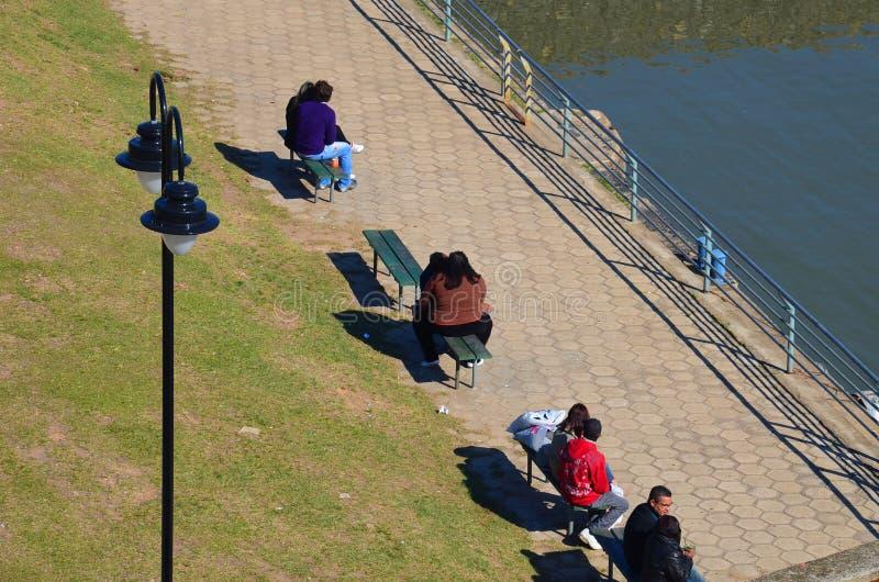 Porto Alegre, Rio Grande do Sul,Brazil : loving couples resting near the lake Guaiba stock image
