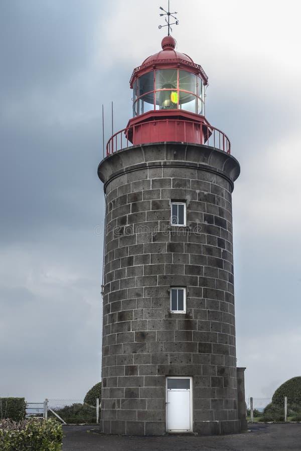 Porto bonito de Grandville, com o farol em Brittany, franco imagem de stock