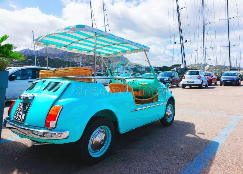 Golf cart in parking Porto Cervo Sardinia royalty free stock photo