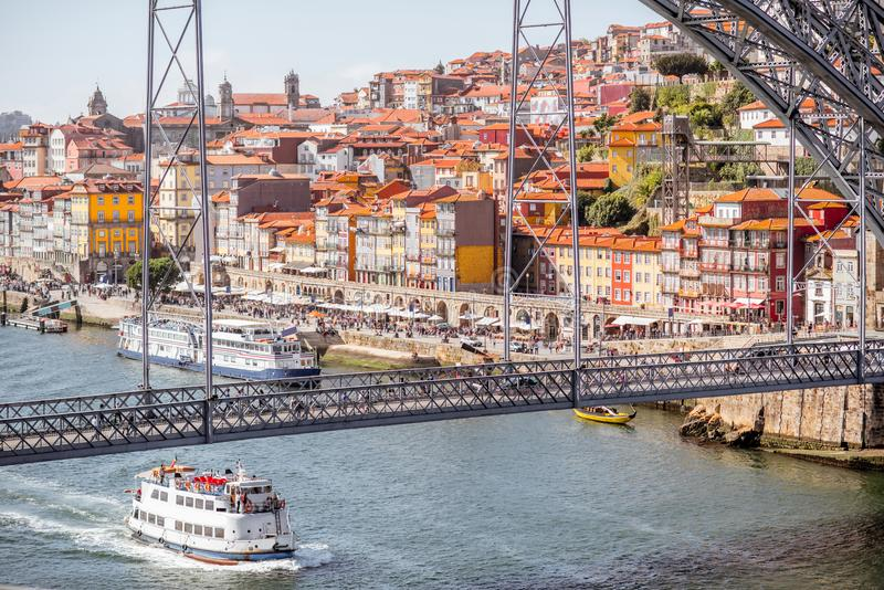 Porto city in Portugal. Landscpe view on the Douro river with cruis ship and beautiful iron bridge in Porto city, Portugal royalty free stock photography