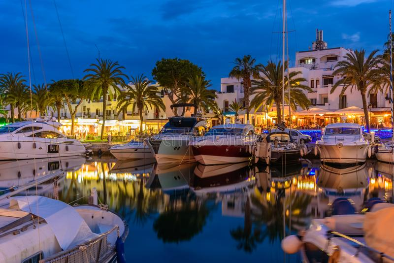 Porto Cristo in evening lights. Mallorca island. Porto Cristo in evening lights. Traditional boats illuminated at twilight in Palma de Mallorca island, Spain royalty free stock photo
