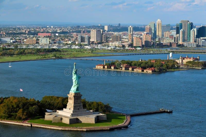 Porto de New York da estátua da liberdade fotografia de stock