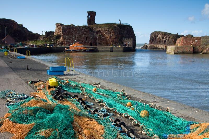 Porto di Dunbar e castello, Lothian orientale Scozia fotografia stock