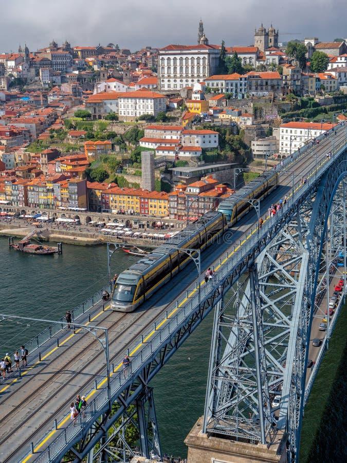 Porto Metro Train, Dom Luis 1 Bridge, Vila Nova de Gaia, Portugal. A Porto Metro train and pedestrians crossing the Dom Luis 1 Bridge that spans the River Douro stock photo