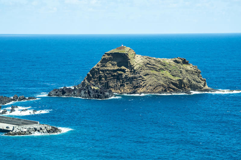 Porto Moniz on the North West Coast where the Mountains in the north of the Island of Madeira meet the Atlantic Ocean. Madeira is a very mountainous Island with stock image