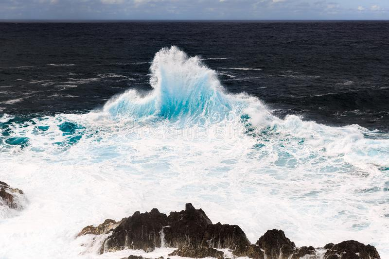 Porto Moniz waves. Beautiful seascape view of the big waves crashing at the shore at Porto Moniz, on the north coast of Madeira island royalty free stock photography