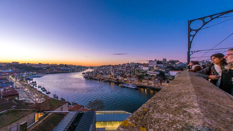 Porto Old Town and the Dom Luis Bridge during sunset. PORTO, PORTUGAL - CIRCA JANUARY 2018: View on the illuminated Old Town and the Dom Luis Bridge at the River royalty free stock photos