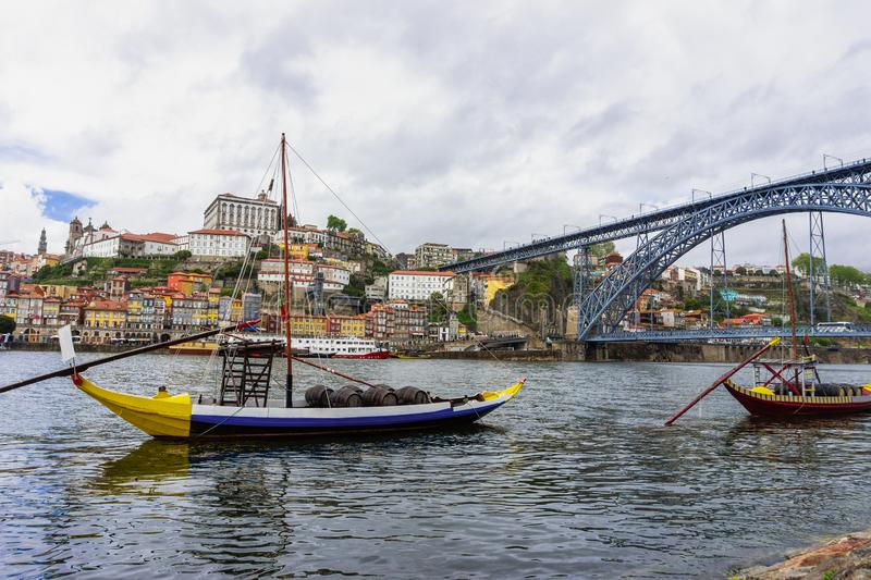 Porto old town skyline on the Douro River with rabelo boats. Porto, Portugal old town skyline on the Douro River with rabelo boats, city, wine, bridge, europe royalty free stock image